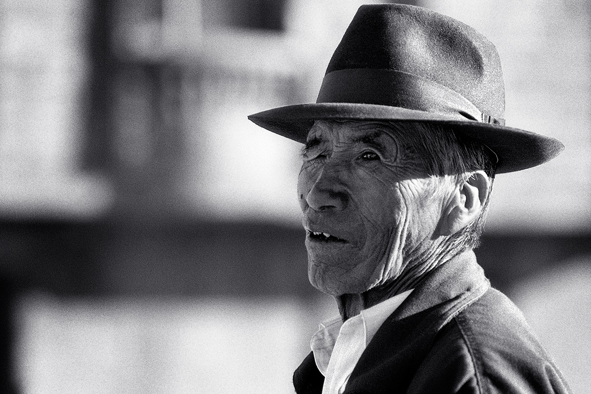 Portrait of an old bolivian man wearing a hat